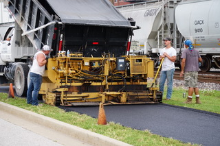 The asphalt layer is applied in two passes.