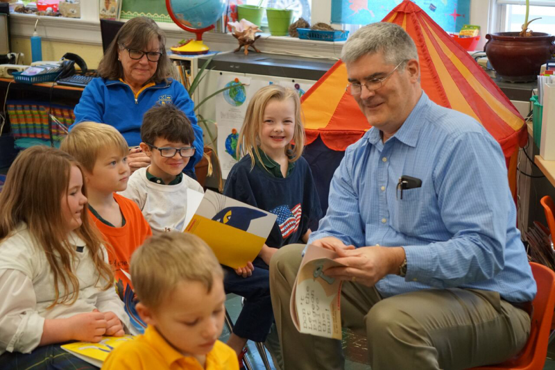 Mike Fitzgerald reads to students at St. Peter and Paul Catholic Grade School.