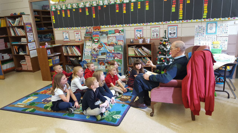 Tom Juravich reads to students at St. Ambrose Catholic Grade School.
